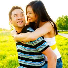 Man And Woman Playfully Smiling