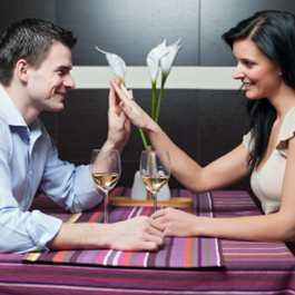 Smailing couple touching hands